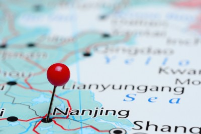 Photo of pinned Nanjing on a map of Asia.